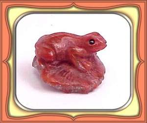 21.0ct FOSSILIZED RED HORN CORAL CARVED FROG **